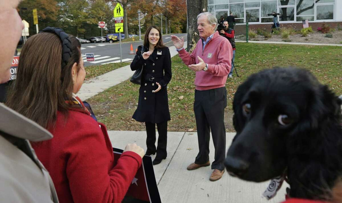 Republican candidate for governor Tom Foley thanks supporters after voting at the Glenville School in Greenwich, Conn., Tuesday, Nov. 4, 2014. Foley is facing incumbent Democratic Gov. Dannel Malloy in the general election. At left is Foley's wife Leslie. (AP Photo/Charles Krupa)