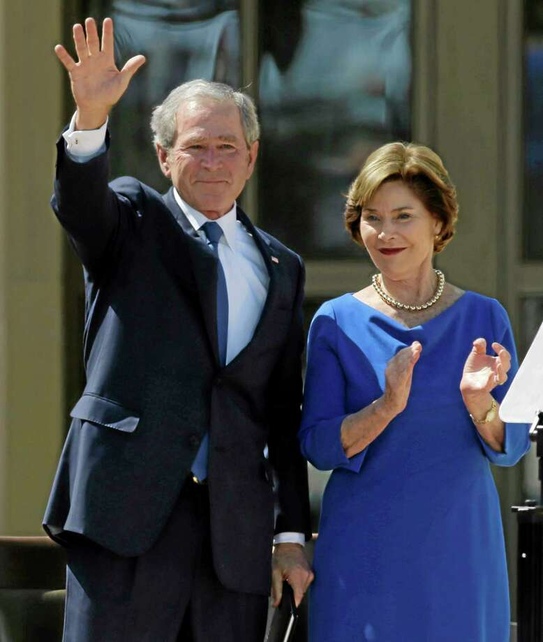 Former president George W. Bush waves with  his wife Laura speech during the dedication of the George W. Bush Presidential Center Thursday, April 25, 2013, in Dallas. (AP Photo/David J. Phillip) Photo: AP / AP