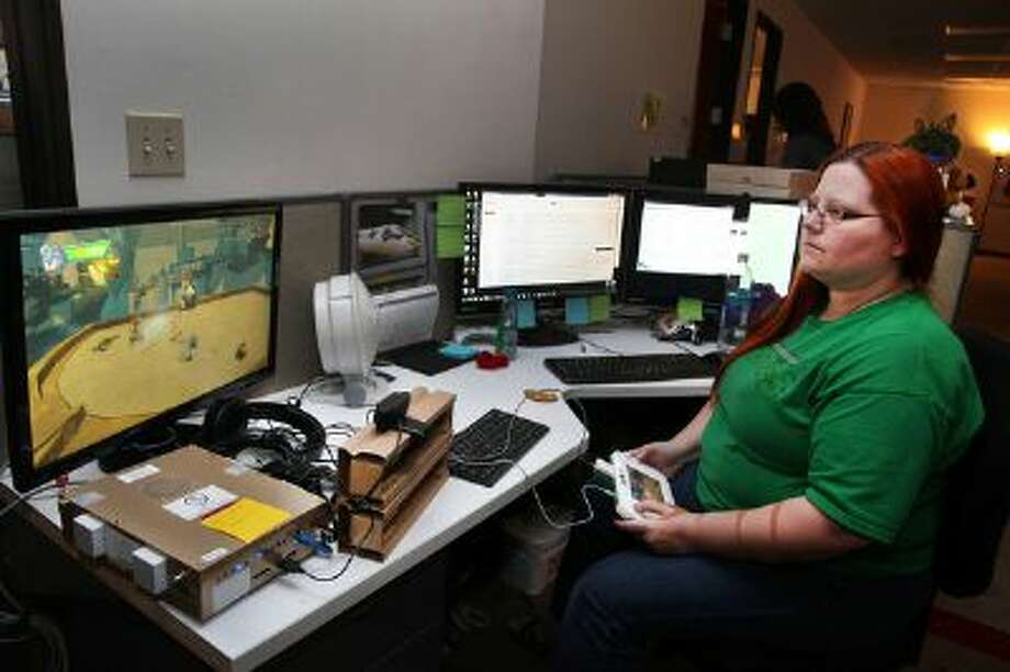 In this Tuesday, Jan. 28, 2014 photo, Big Red Button Entertainment quality assurance tester Amanda Rose plays the new Sonic the Hedgehog video game Sonic Boom in El Segundo, Calif. Sega s speedy 22-year-old mascot and his friends are getting makeovers for the upcoming game and Cartoon Network series of the same name. Photo: AP / AP net