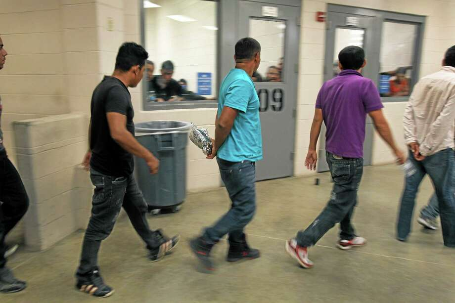 Immigrants who have been caught crossing the border illegally are housed inside the McAllen Border Patrol Station in McAllen, Texas where they are processed on Tuesday, July 15, 2014.  More than 57,000 unaccompanied children have been apprehended at the southwestern border since October, more than twice the total this time last year, many through the Rio Grande Valley. (AP Photo/Los Angeles Times,  Rick Loomis, Pool) Photo: AP / Los Angeles Times Pool