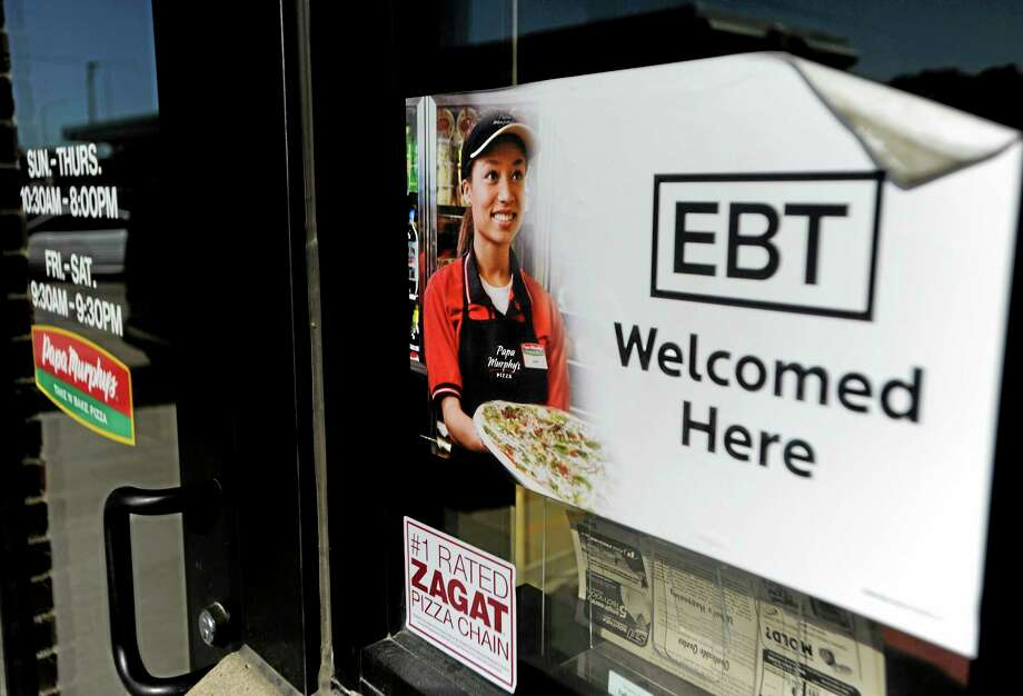 FILE - In this Aug. 26, 2011 photo, a sign notifies customers that EBT can be used at a store in Sioux Falls, S.D.  House and Senate negotiators are set to begin crafting a compromise farm bill, including cuts to the food stamp program. The talks open Wednesday, Oct. 30, 2013, just two days before food stamp recipients will see a separate, unrelated cut in their monthly benefits. (AP Photo/The Argus Leader, Jay Pickthorn) THE DAILY REPUBLIC OUT;  NO SALES Photo: AP / Argus Leader