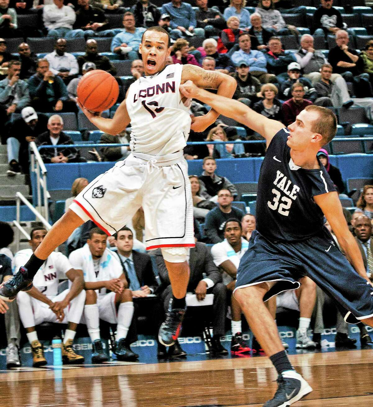 UConn's Shabazz Napier is fouled by Yale's Greg Kelly in the second half on Monday.