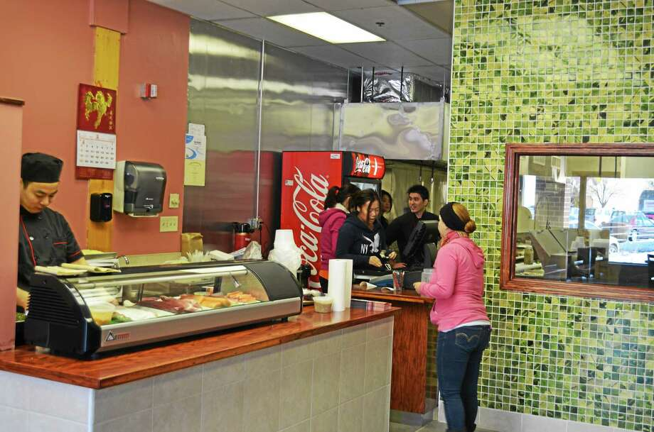 Sushi chef Paul Lin, owner Lan Zhen Li, Ching Cheng, Linda Cheng and Kevin Chen opened Hibachi Express to provide a quick hibachi option to Torrington. Photo: Kate Hartman—Register Citizen