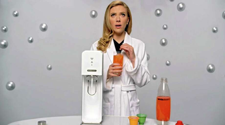 This undated frame grab provided by SodaStream shows the company's 2014 Super Bowl commercial featuring actress Scarlett Johansson promoting its at-home soda maker. Photo: THE ASSOCIATED PRESS — SodaStream  / SodaStream
