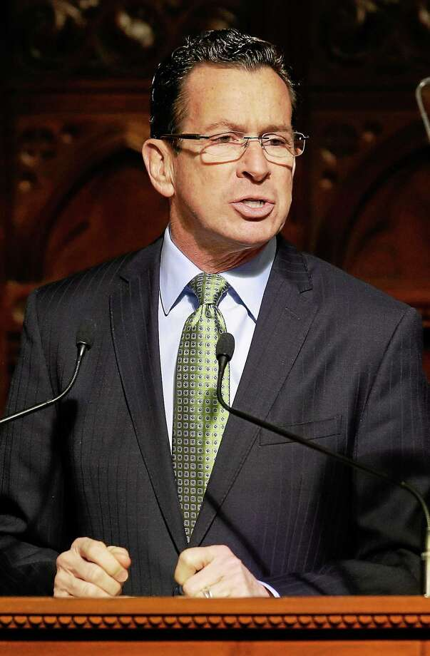 (AP Photo/Stephan Savoia) Connecticut Gov. Dannel P. Malloy gestures with his fists as he emphasizes a point during his 2014 State of the State address. Photo: AP / AP