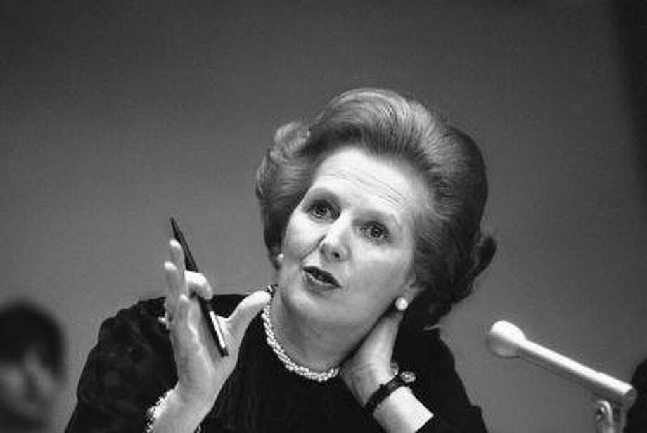 """FILE - In this June 23, 1982 file photo, Britain's Prime Minister Margaret Thatcher gestures with her pen as she answers a reporters question during a news conference at the United Nations. Ex-spokesman Tim Bell says that Thatcher has died. She was 87. Bell said the woman known to friends and foes as """"the Iron Lady"""" passed away Monday morning, April 8, 2013. (AP Photo/File) Photo: AP / AP"""