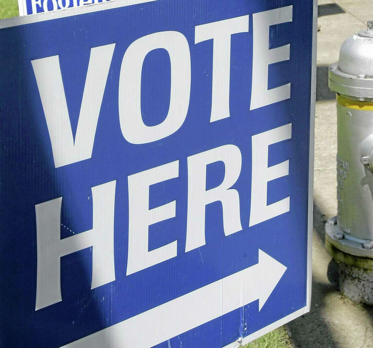 """This May 3, 2010, file photo shows a """"vote here"""" sign near a polling place open for early voting."""