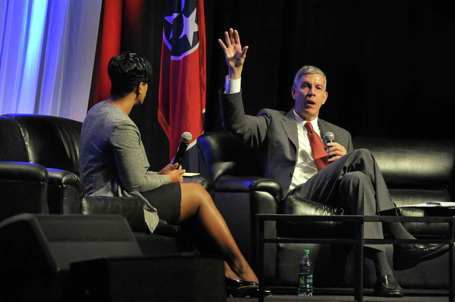 U.S. Education Secretary Arne Duncan, right, answers questions through moderator Sheryl Randolph, of Hamilton County at the LEAD education conference at the Music City Center, Tuesday, Oct. 28, 2014, in Nashville, Tenn. Duncan spoke about the importance of strong school leadership. (AP Photo/The Tennessean, John Partipilo) Photo: AP / The Tennessean