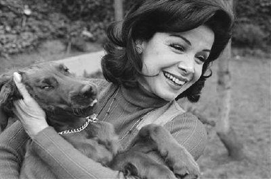Former Mouseketeer Annette Funicello gets an enthusiastic greeting from Skippy, her Irish setter puppy, at home in Encino, Calif., March 13, 1978. Funicello passed away on April 8, 2013 due to complications from Multiple Sclerosis. (AP Photo/George Brich) Photo: AP / AP