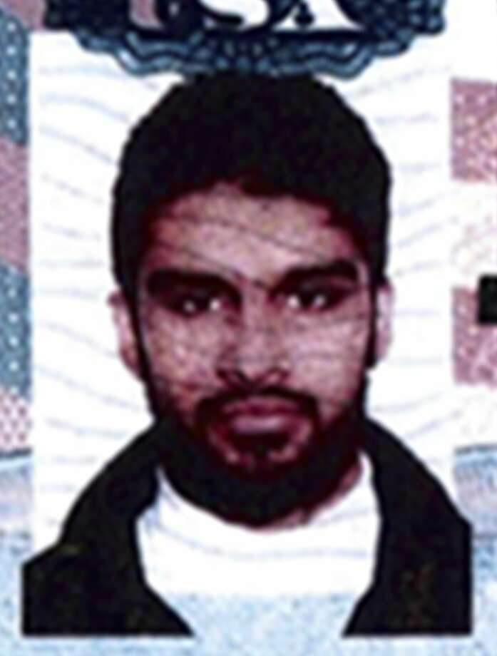 This undated passport photo provided by the U.S. attorney's office and presented as evidence at a detention hearing at federal court in Chicago, Monday, Nov. 3, 2014, shows Mohammed Hamzah Khan. Photo: (AP Photo/U.S. Attorneyís Office) / U.S. attorney's office in Chicago