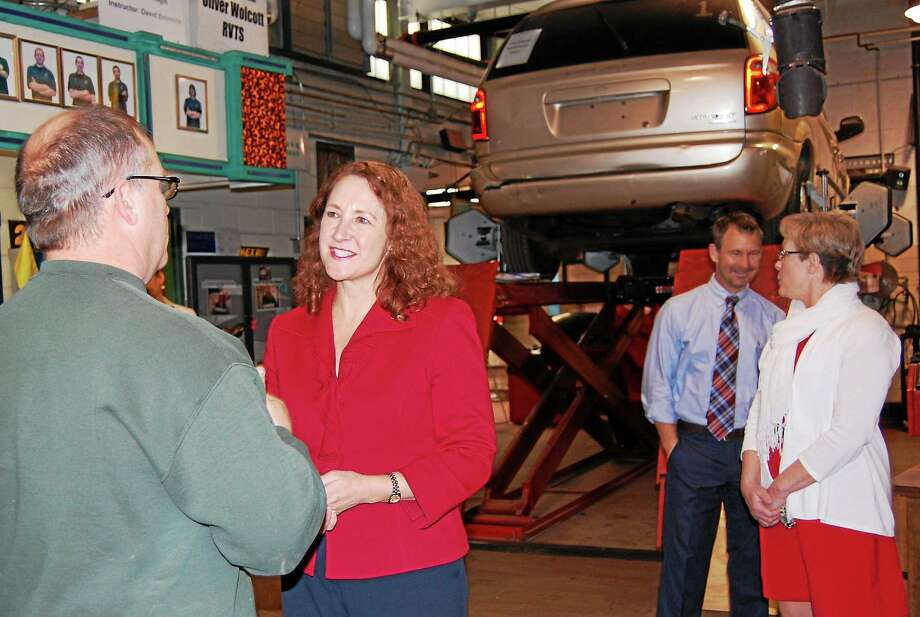 U.S. Rep. Elizabeth Esty talks with Ray Royals, department head for the automotive technology program at Wolcott Technical High School Friday. Photo: Jenny Golfin—Register Citizen