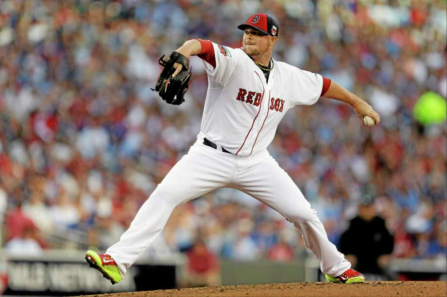 Jon Lester and the Boston Red Sox will be looking to make a move up the standings in the second half of the season. Photo: Jeff Roberson — The Associated Press  / AP