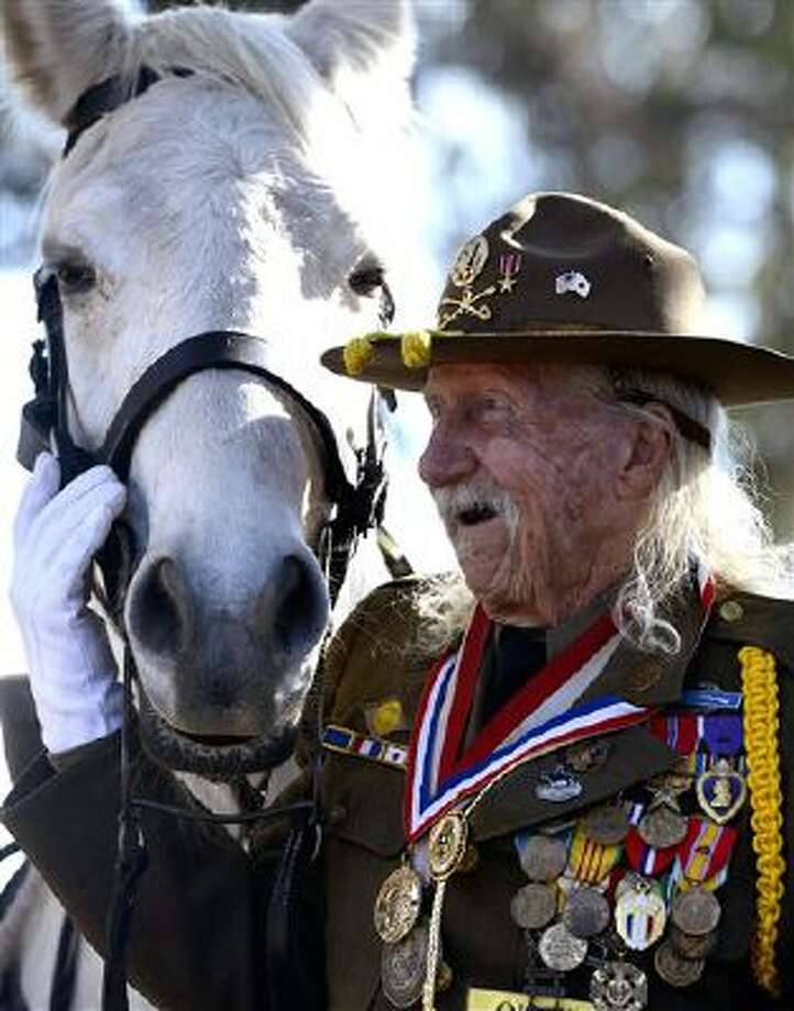 Cavalryman Sgt. Allan MacDonald gives his horse Comanche II a hug as he is honored for his 90th birthday during a Veterans Day Celebration at the site of the old Fort Ord veterinary hospital at the Marina Equestrian Center in Marina, Calif., on Saturday. MacDonald is a veteran of World War II. Photo: AP / Monterey County Herald