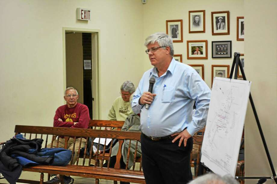 Robert Simmons, a chief hydrogeologist, spoke to the Winsted Board of Selectmen on behalf of HRP Associates Inc. regarding the company's plan to study the blighted Lambert Kay site at 32 Lake St. Monday. Photo: Ryan Flynn — THe Register Citizen