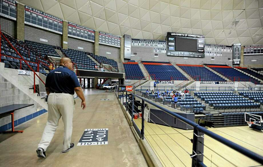 UConn athletic director Warde Manuel walks through Gampel Pavilion in Storrs on Tuesday. Manuel says he supports providing additional stipends to student-athletes, but does not believe they should be allowed to unionize. Photo: Jessica Hill — The Associated Press  / FR125654 AP