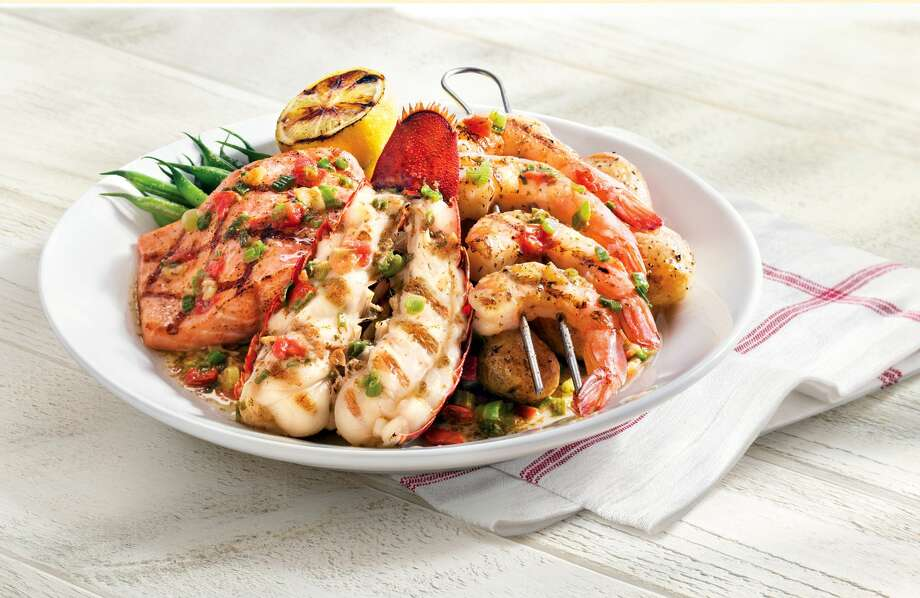 Red Lobster's new Wood-Grilled Lobster, Shrimp and Salmon dish. Photo: The Associated Press — Red Lobster  / Red Lobster