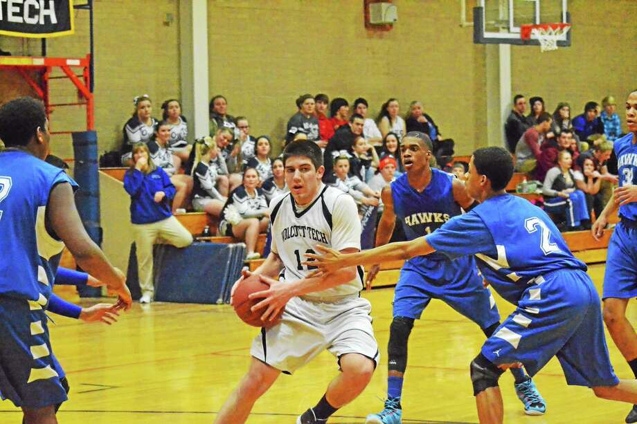 Wolcott Tech's Luke Pergola drives through the lane against Vinal Tech. Pergola finished with 28 points and is 13 points away from reaching 1,000 points for his career. Photo: Pete Paguaga — Register Citizen