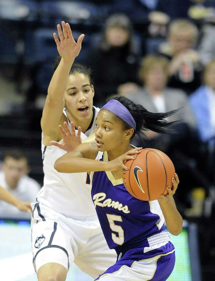 UConn's Kia Nurse (11) guards West Chester's Porscha Speller during the first half Sunday in Storrs. Photo: Fred Beckham — The Associated Press  / FR153656 AP