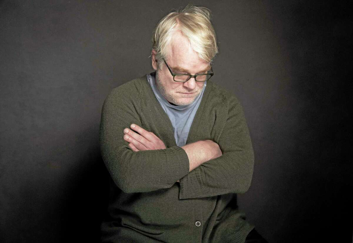 This photo taken Jan. 19, 2014, shows Phillip Seymour Hoffman posing for a portrait at The Collective and Gibson Lounge Powered by CEG, during the Sundance Film Festival, in Park City, Utah. Hoffman, who won the Oscar for his portrayal of writer Truman Capote and created a gallery of slackers, charlatans and other characters so vivid that he was regarded as one of the world's finest actors, was found dead in his New York apartment Sunday with what officials said was a needle in his arm. He was 46. (Photo by Victoria Will/Invision/AP)