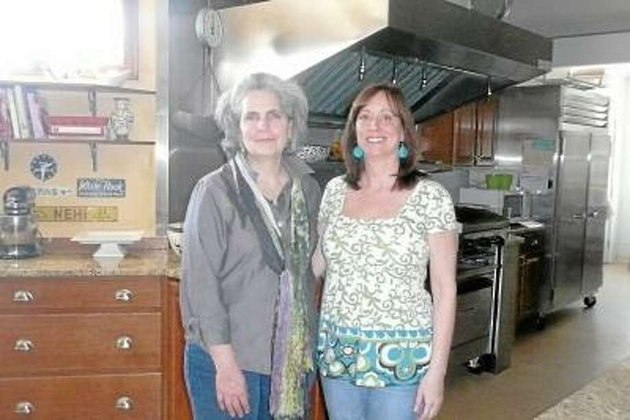 Kate Hartman/Register Citizen. Charlene Goodman Dutka and Darcy Manchak in their commercial kitchen at 184 S. Main St.