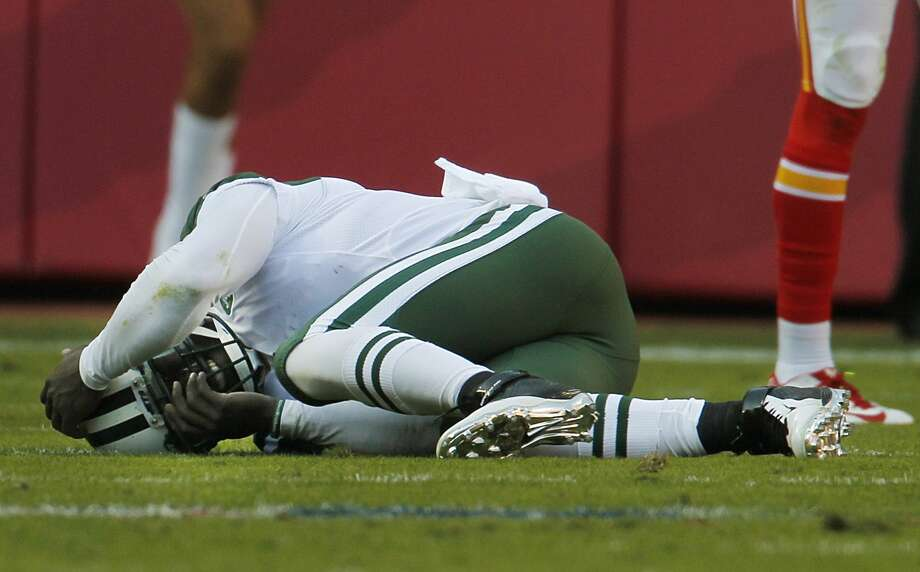 Jets quarterback Michael Vick (1) lies injured on the field in the second half Sunday. Photo: Colin E. Braley — The Associated Press  / FR123678 AP