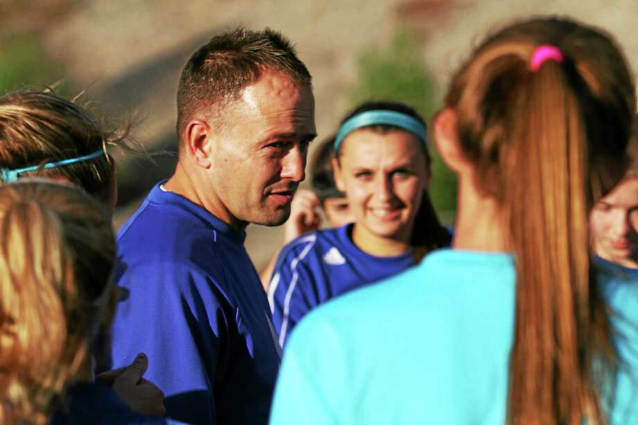 Lewis Mills girls soccer head coach Dennis Fowler talks to his team during practice last week. Photo: Marianne Killackey — Special To Register Citizen  / 2014