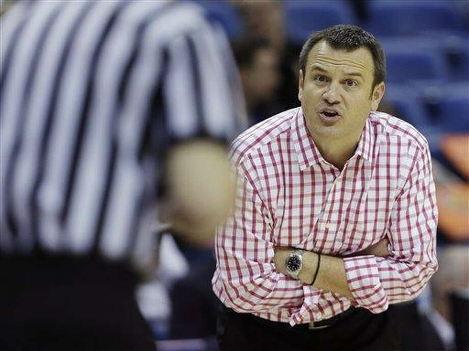 Louisville head coach Jeff Walz argues a call with an official in the second half against California during a national semifinal at the Women's Final Four of the NCAA college basketball tournament, Sunday, April 7, 2013, in New Orleans. (AP Photo/Dave Martin) Photo: AP / AP