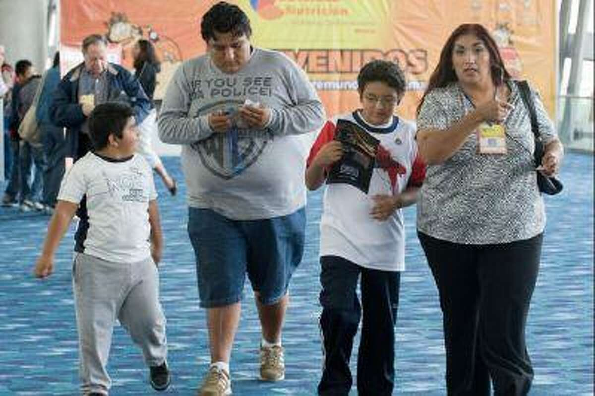 Overweight Mexicans attend the World Summit against Obesity, in Mexico City, in 2009.
