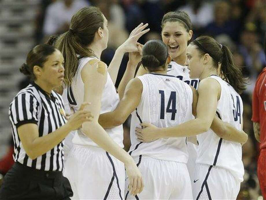 Connecticut players react during first half of the national championship game against Louisville at the women's Final Four of the NCAA college basketball tournament, Tuesday, April 9, 2013, in New Orleans. (AP Photo/Gerald Herbert) Photo: AP / AP