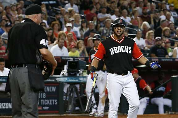 Arizona Diamondbacks' David Peralta, right, argues with umpire Ron Kulpa, left, after being thrown  out of a baseball game during the fifth inning against the San Francisco Giants, Sunday, Aug. 27, 2017, in Phoenix. (AP Photo/Ross D. Franklin)