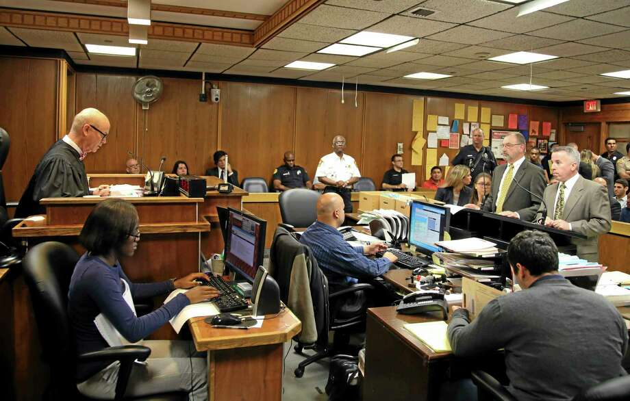 Judge William Altfield, far left, presides in court as assistant state attorney David Gilbert, left, and defense attorney Mark Shapiro, right, present their case during a hearing to determine whether pop star Justin Bieber will be tried on charges  of driving under the influence and resisting arrest, Wednesday, July 16, 2014, in Miami. Bieber was arrested Jan. 23 in Miami Beach after what police described as an illegal street race between Bieber and a friend. Bieber did not attend the hearing. Another hearing was set for August 5. (AP Photo/Fernando Castells, Pool) Photo: AP / AP Pool