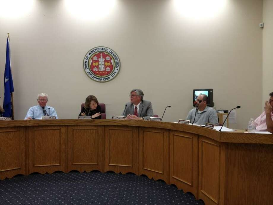 Superintendent of schools Thomas Danehy talking, flanked by board chair Susan Hoffnagle and board member Richard Dutton to his right. To his left, board member Brian Shaughnessy. -- Jason Siedzik / Register Citizen