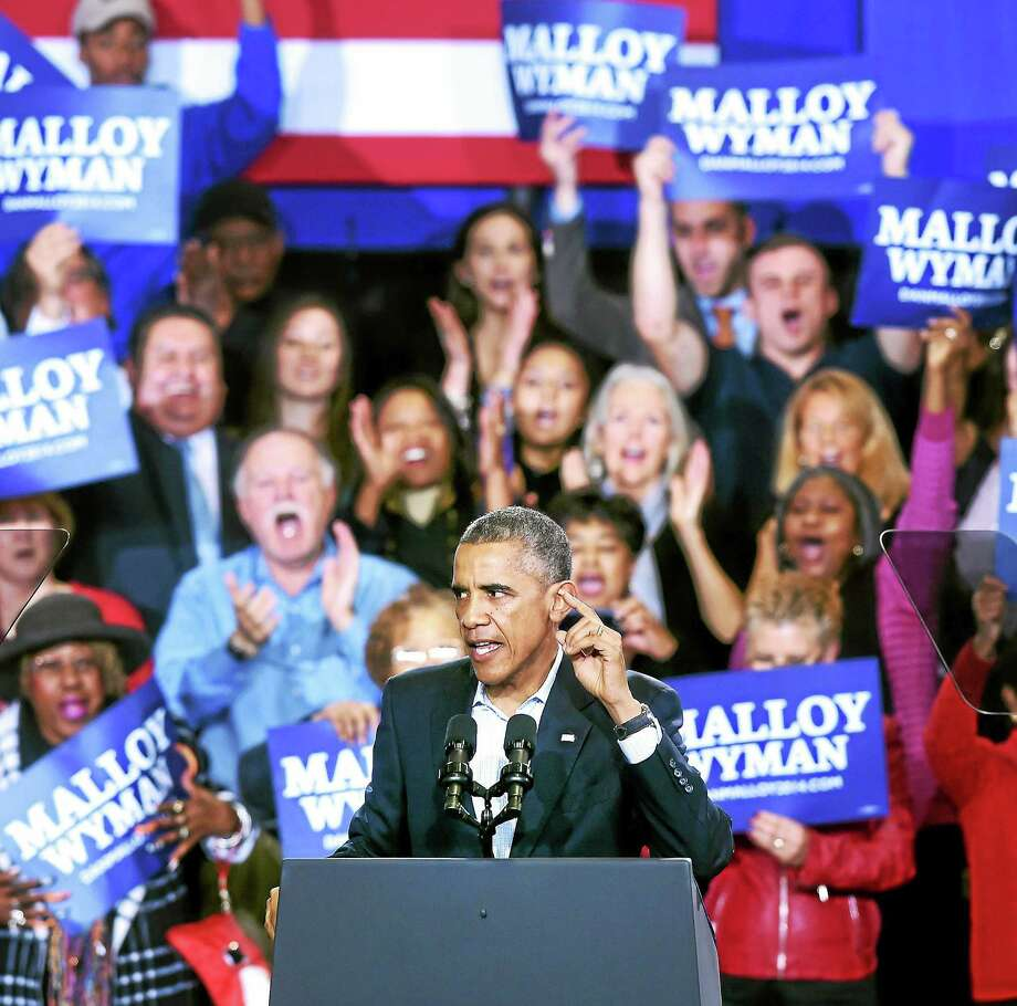 President Barack Obama campaigns for Gov. Dannel Malloy at Central High School in Bridgeport on Sunday. Photo: (Arnold Gold — New Haven Register)