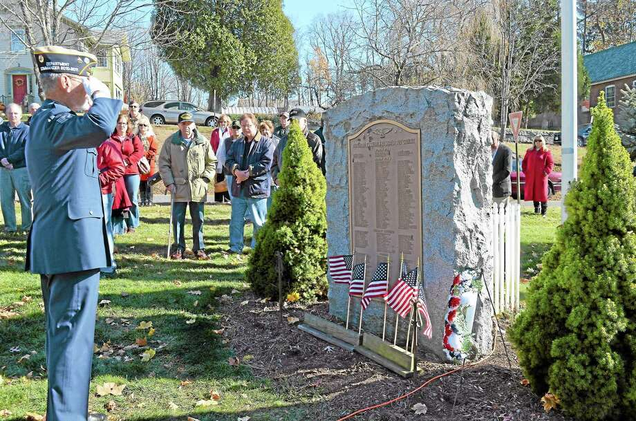 Dan Thurston, a Vietnam veteran and community veterans affairs leader, saluted the war memorial on the Harwinton Town Green during the Veteran's Day Ceremony. Photo: Kate Hartman—Register Citizen