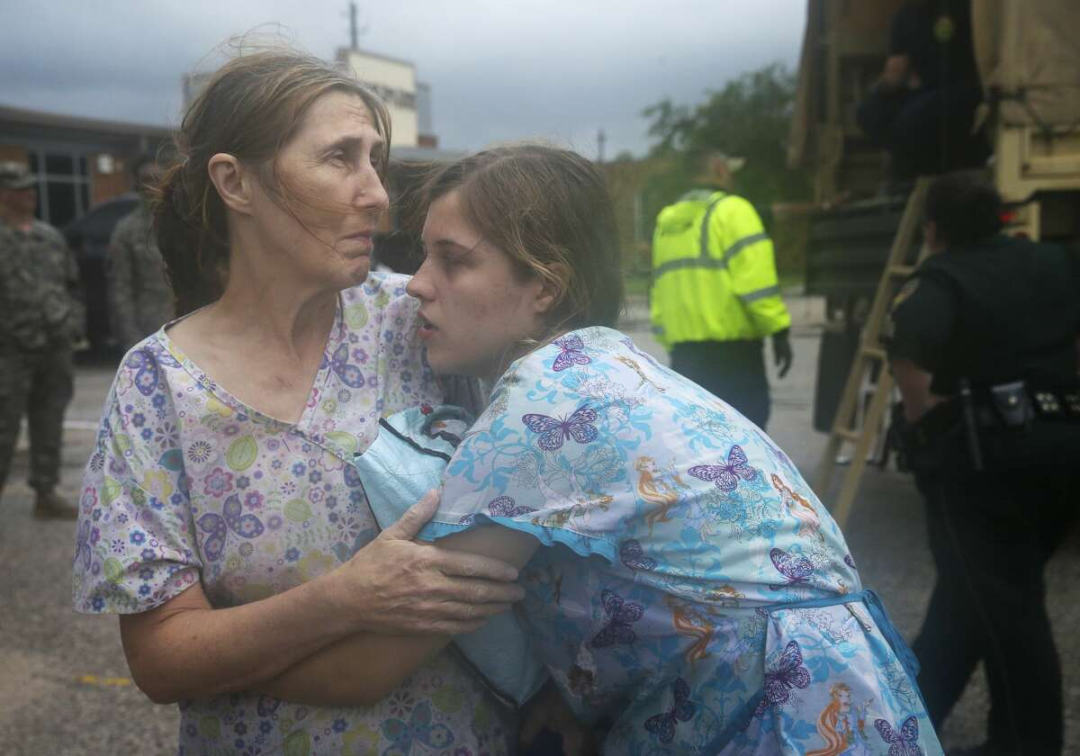 La Vita Bella Personal Care Home worker Susan Woodruff and her daughter, Shantell, 17, console each other after rescued by Army National Guard and dropped off at a stage shelter along with other workers and 11 out of 15 patients Sunday, Aug. 27, 2017, in Santa Fe. The mother and daughter both were working at the personal care facility and scared that they would die in the flood. Despite they made it safe to the stage shelter, Susan Woodruff was still worried about her missing husband and son at home. ( Yi-Chin Lee / Houston Chronicle )