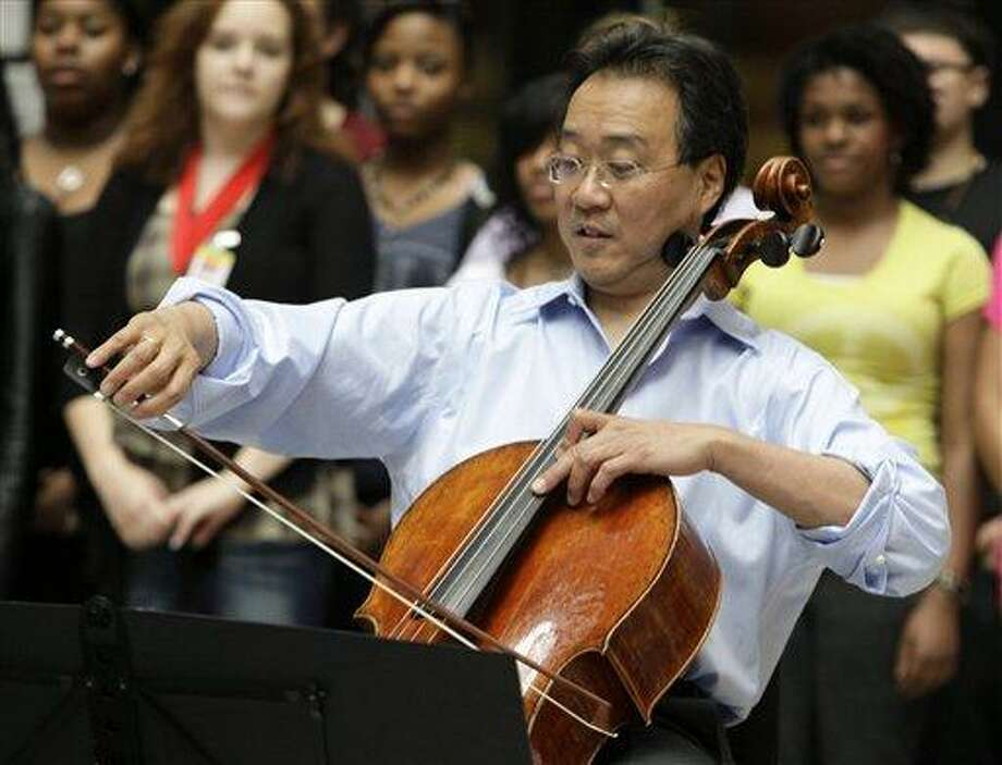 (AP Photo/Kiichiro Sato, File) In this March 19, 2012 file photo, world-famous cellist Yo-Yo Ma plays in the rotunda of the State of Illinois building, the James R. Thompson Center, in Chicago. Yo-Yo Ma and former Guns N' Roses drummer Matt Sorum were on Capitol Hill Tuesday to urge lawmakers to increase funding for the arts in a year of deep federal budget cuts. Photo: AP / AP