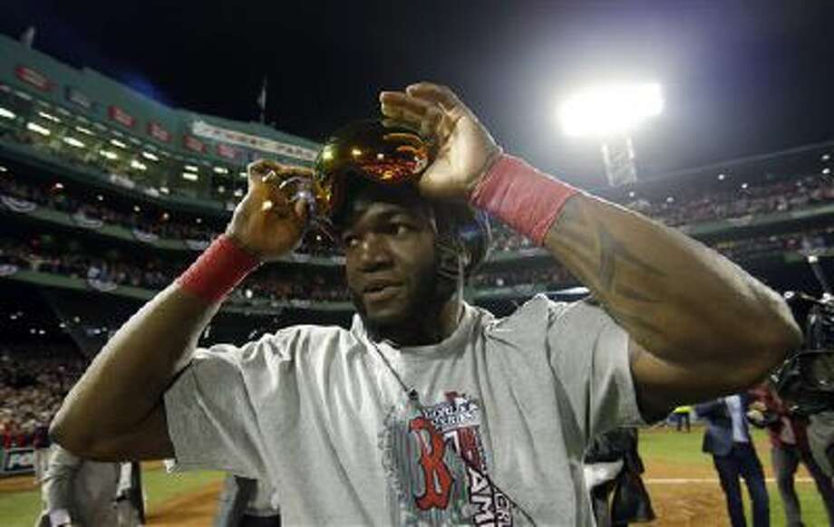 In this Oct. 30, 2013 file photo, Boston Red Sox's David Ortiz adjusts his goggles after the Boston Red Sox defeated the St. Louis Cardinals in Game 6 of baseball's World Series in Boston. Photo: AP / AP