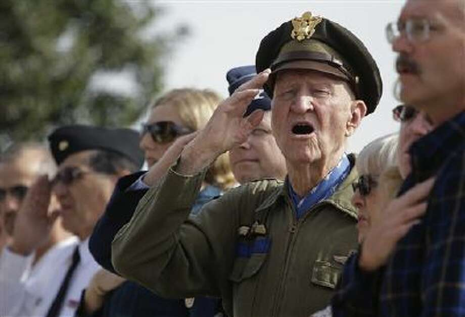 """Retired Col. Gail Halvorsen sings """"The Star-Spangled Banner"""" as the colors are presented during a Veterans Day ceremony at Fort Sam Houston National Cemetery, Monday, Nov. 11, 2013, in San Antonio. Photo: AP / AP"""