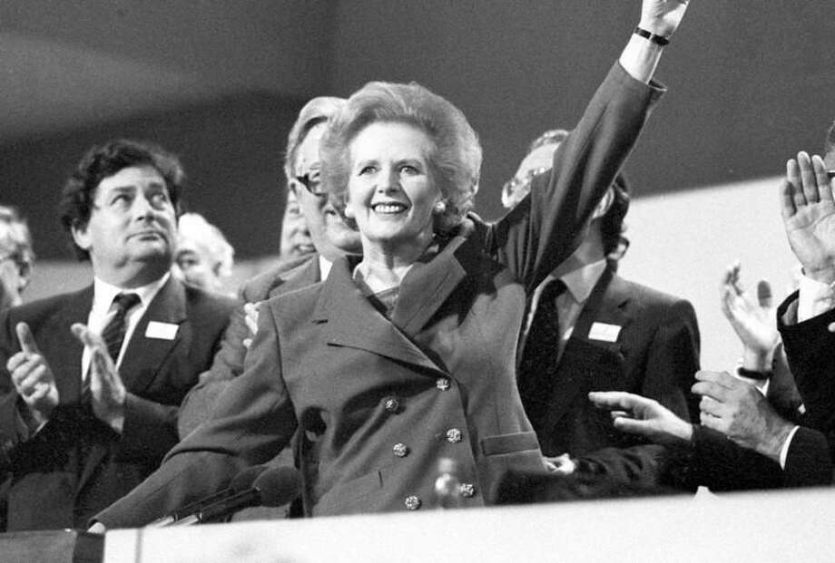 Then British Prime Minister Margaret Thatcher points skyward as she receives standing ovation at Conservative Party Conference in this October 13, 1989 file photo. Thatcher has died following a stroke, a spokesman for the family said. REUTERS/Stringer/Files Photo: REUTERS / X80002