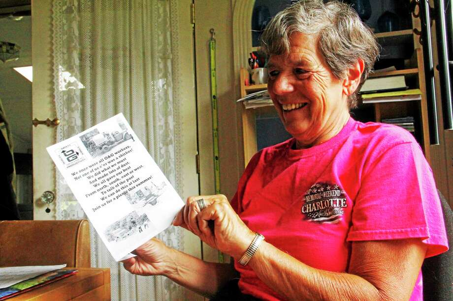 Esteban L. Hernandez — Register CitizenTracy McKeon, a retired employee of O&G Industries, holds an invitation on Wednesday at her home. She sent it to more than 150 people. The invitations are for a retiree reunion picnic on Sunday. Photo: Journal Register Co.