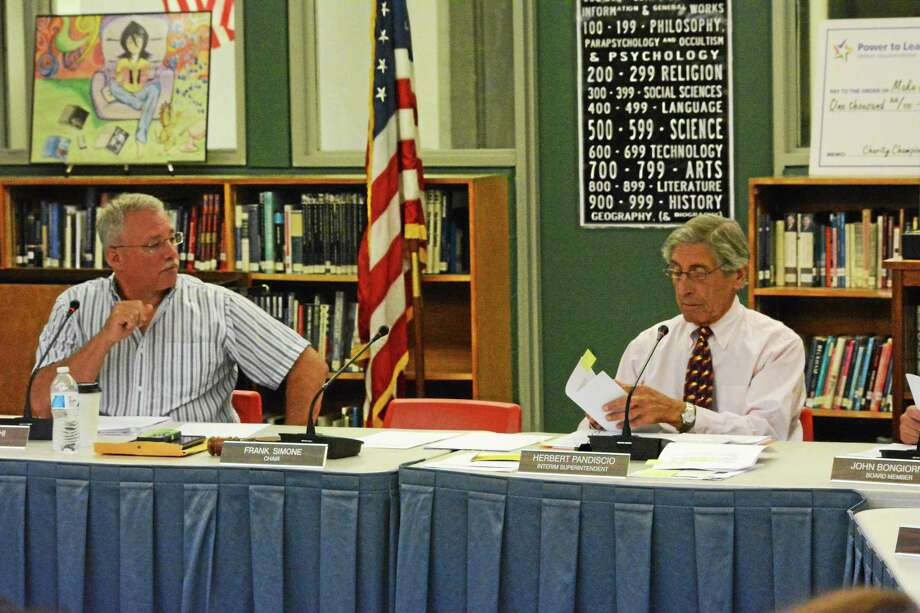 Wayne Shuhi of the Board of Education and interim superintendent Herbert Pandiscio discuss the process of hiring a new district head. Photo: Ryan Flynn — Register Citizen