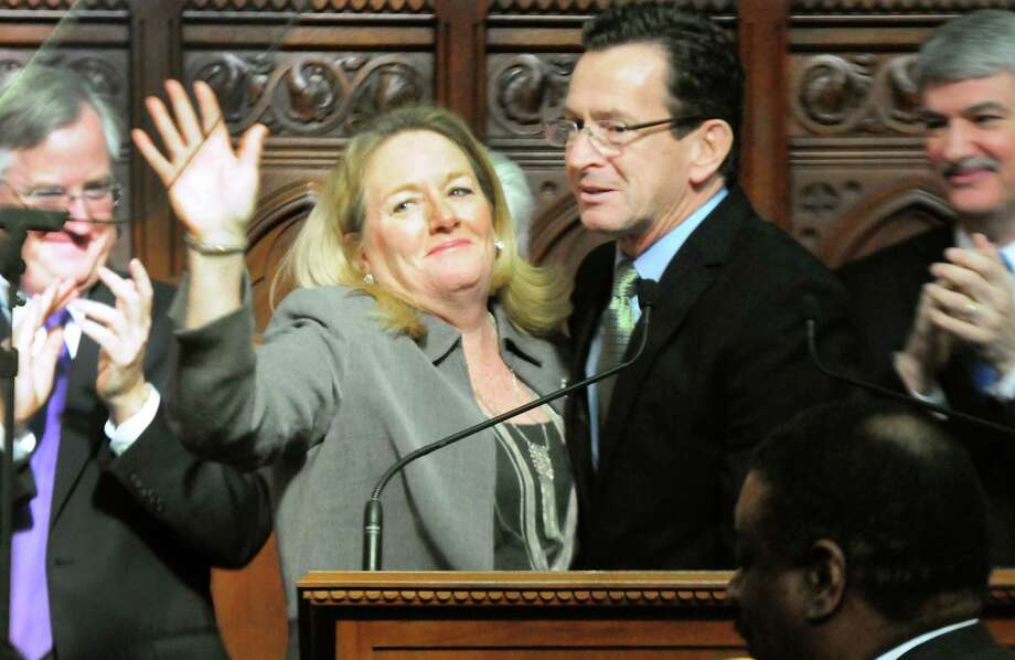 After Gov. Dannell P. Malloy gave his annual State of the State Address to a joint session of the Connecticut General Assembly Thursday, his wife Cathy Malloy waves to a cheering crowd in the Hall of the House of Representatives in Hartford. Photo: Peter Hvizdak — New Haven Register  / ©Peter Hvizdak /  New Haven Register