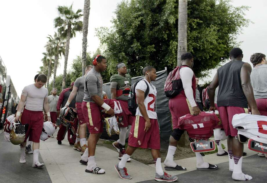 Florida State players walk to the fields for practice on Tuesday in Carson, Calif. Photo: Kelvin Kuo — The Associated Press  / FR170752 AP