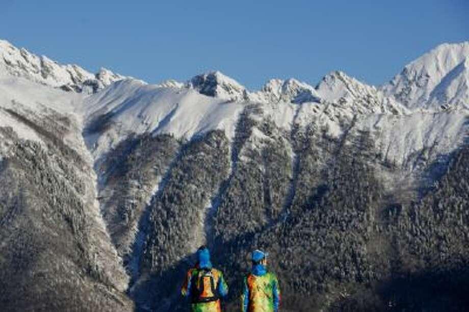 Volunteers look at the mountains at Laura Cross-country Ski & Biathlon Center ahead of the 2014 Winter Olympics in Krasnaya Polyana, Russia. Felipe Dana
