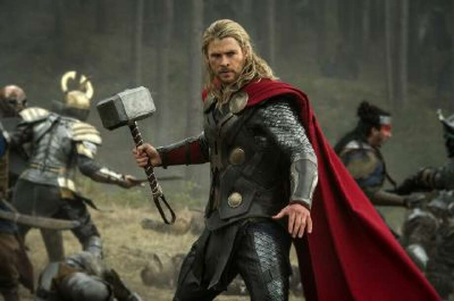 """This publicity photo released by Walt Disney Studios and Marvel shows Chris Hemsworth in a scene from """"Thor: The Dark World."""" The movie releases in the US on Friday, Nov. 8. 2013."""