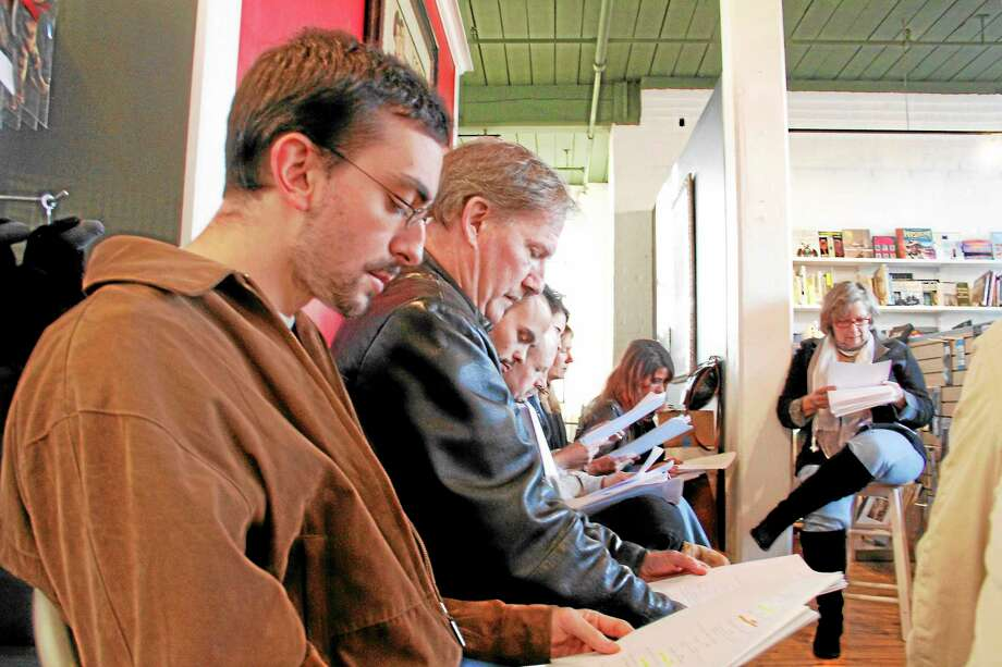 """Actors look down as they read a screenplay by New York transplant Michael Medeiros titled """"Van Helsing of Ipswich"""" during a reading on Sunday, Nov. 11, 2013, at Dickens Books & Arts in Bantam. Photo: Esteban L. Hernandez—Register Citizen"""
