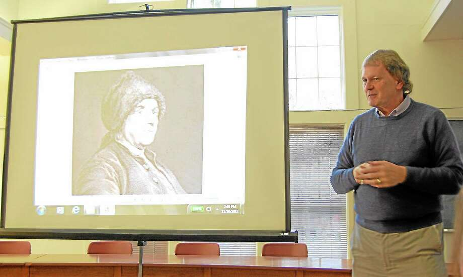 UConn Torrington adjunct history professor Karl Valois delivers a presentation about the Revolutionary War on Sunday, Nov. 10, 2013, in Harwinton's Town Hall. More than 20 community members attended the presentation, which was the finale of a four-part history program. Photo: Esteban L. Hernandez—Register Citizen