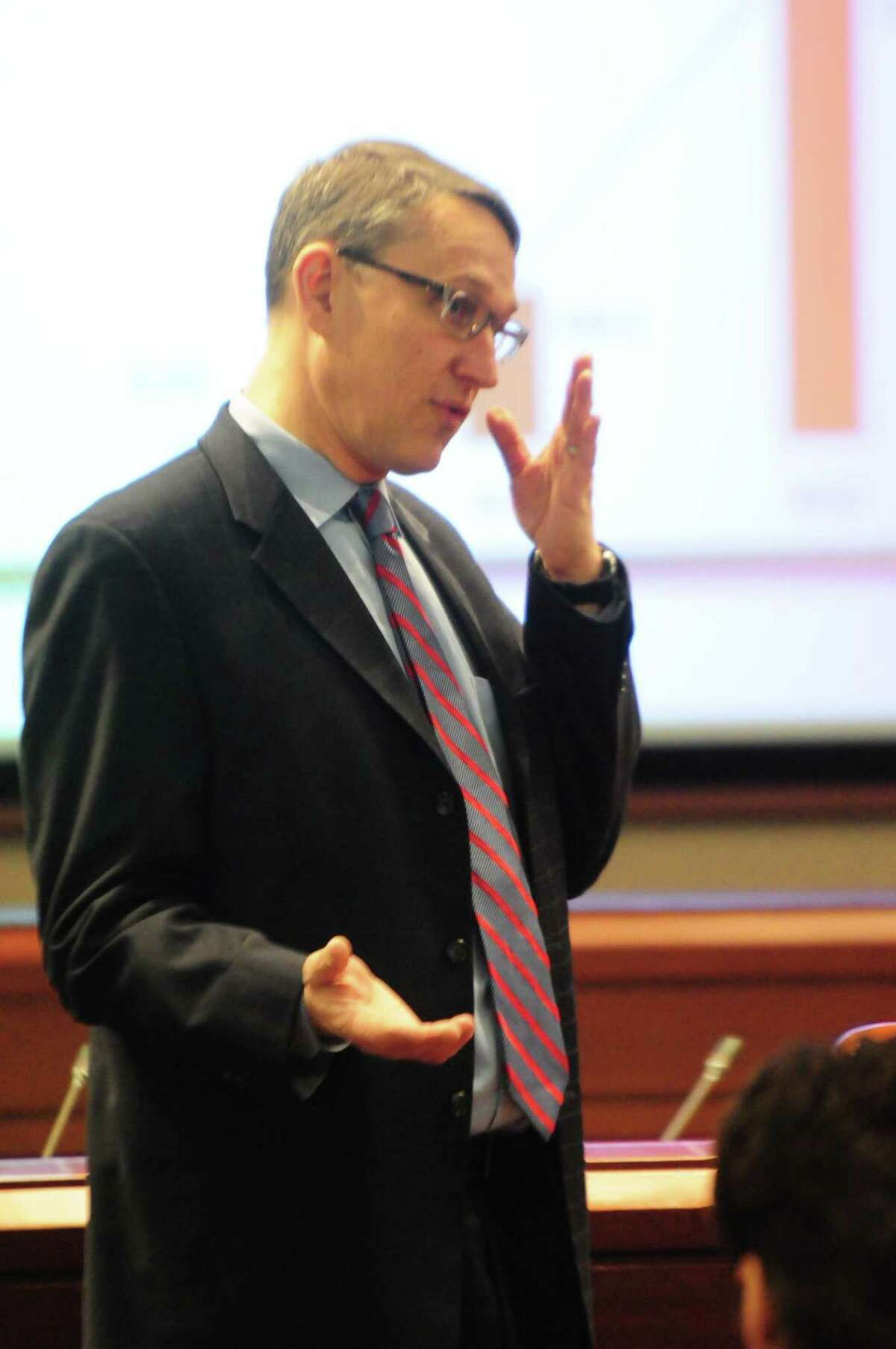 Connecticut Budget Director Ben Barnes gestures as he outlines some fiscal points.