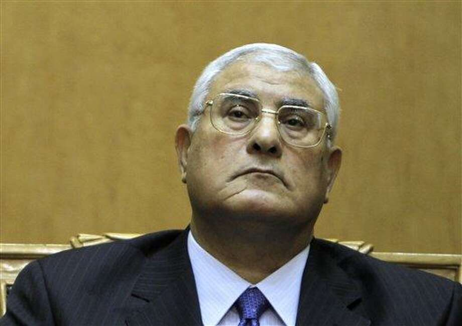 FILE - In this file photo taken Thursday, July 4, 2013, Egypt's chief justice Adly Mansour listens to a speech during his swearing in as interim president. Interim president Mansour held talks Saturday, July 6, 2013, with the army chief and interior minister following an outburst of violence between supporters and opponents of ousted leader Mohammed Morsi that killed at least 36 people across the country and deepened the battle lines in the divided nation. (AP Photo/Amr Nabil, File) Photo: AP / AP