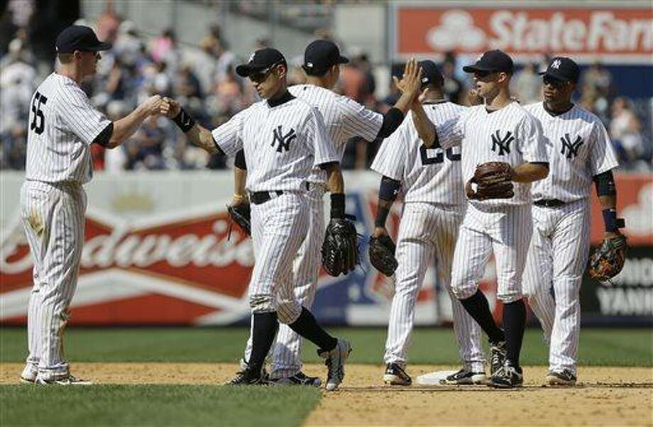 New York Yankees' Ichiro Suzuki, second from left, Lyle Overbay, left, Brett Gardner, second from right, and Robinson Cano, right, celebrate with teammates after a baseball game against the Baltimore Orioles on Saturday, July 6, 2013, in New York. The Yankees won 5-4. (AP Photo/Frank Franklin II) Photo: AP / AP